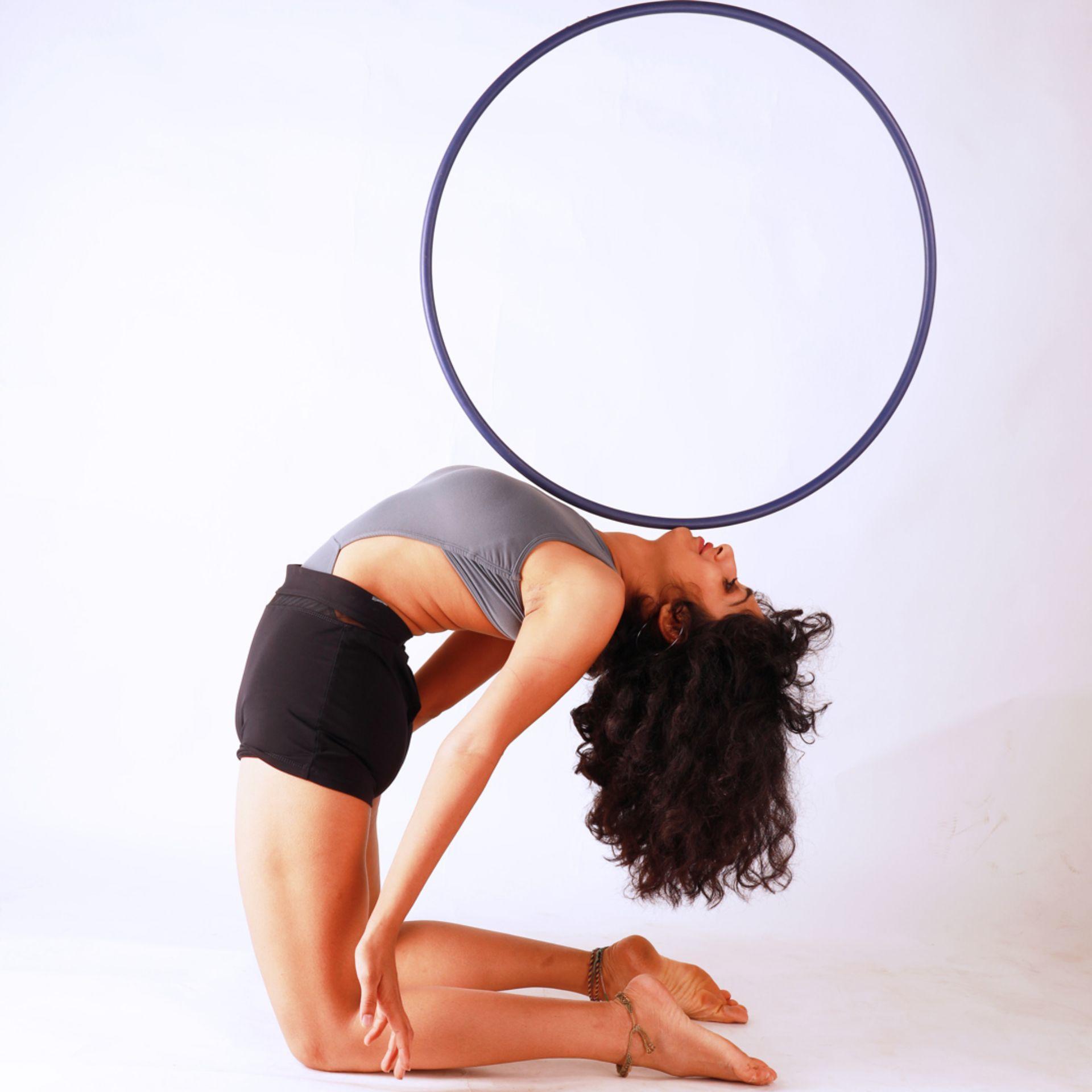 Hoop balance backbend flexibility dance portrait white background