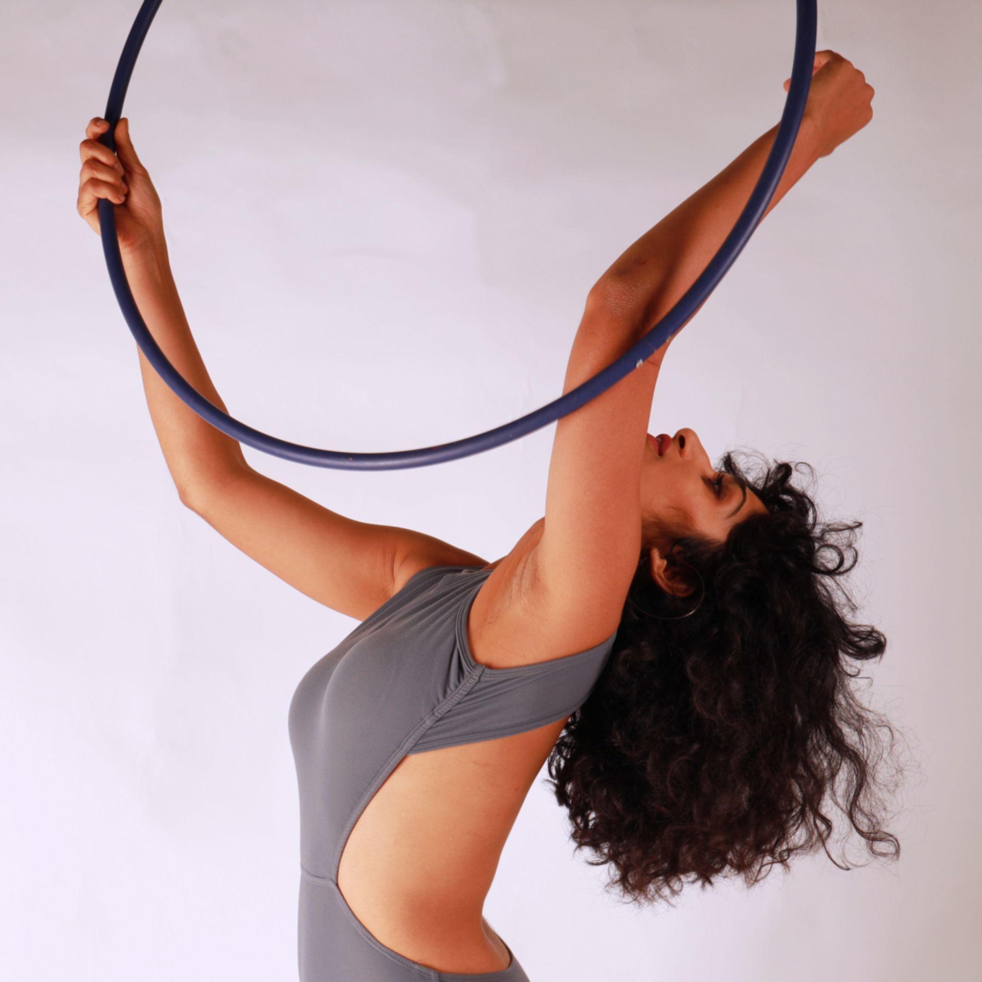 Posing hoop dance single ring hula long hair leotard grey white background