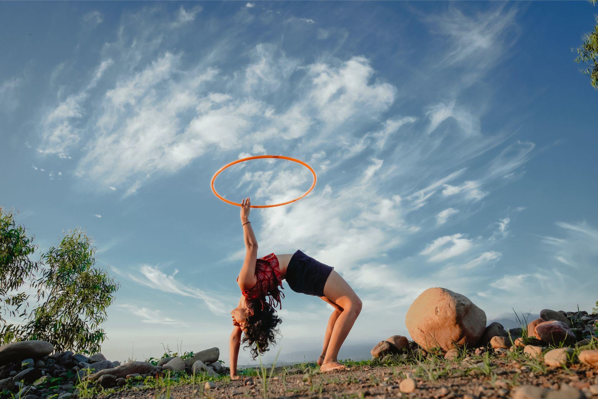 Backbend chakrasana blue sky yellow hoop