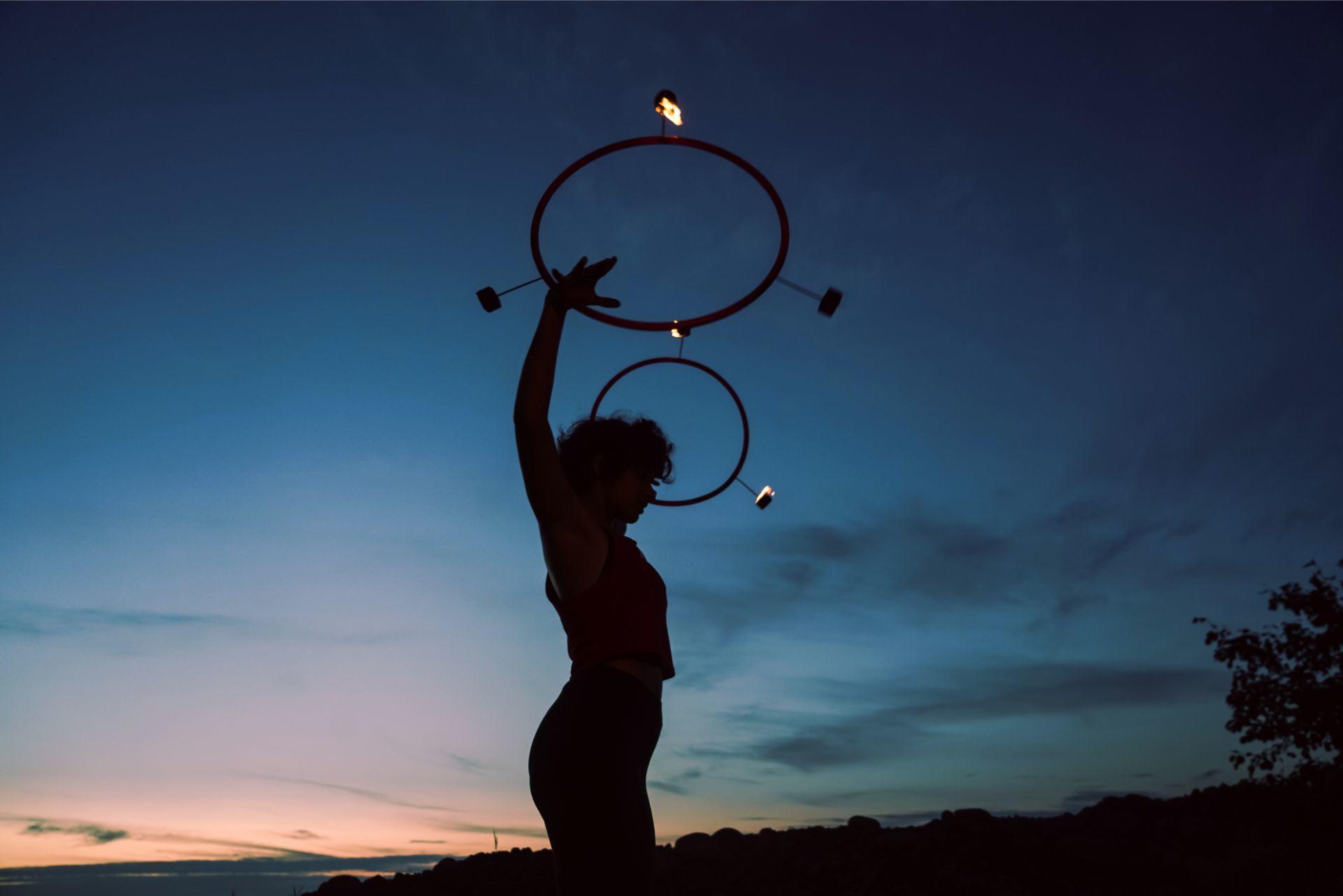 Fire hoop dance red night sky flow dusk double