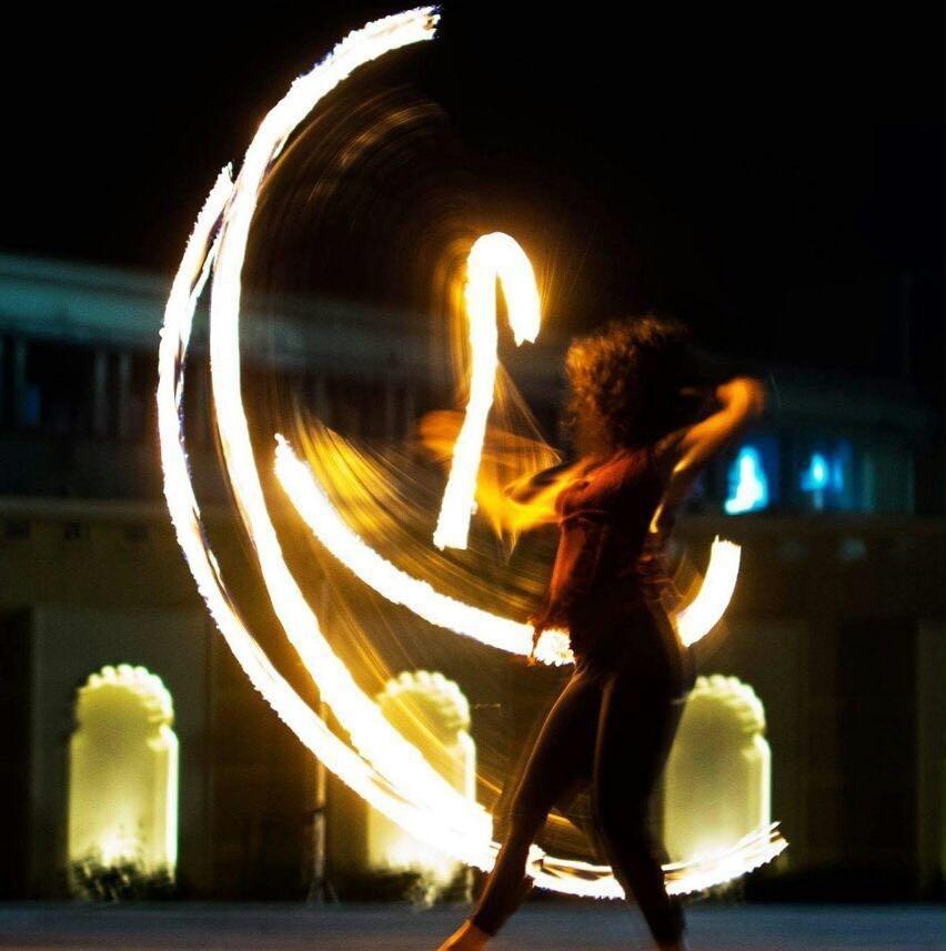 Fire hula hoop performance spinning slowmo