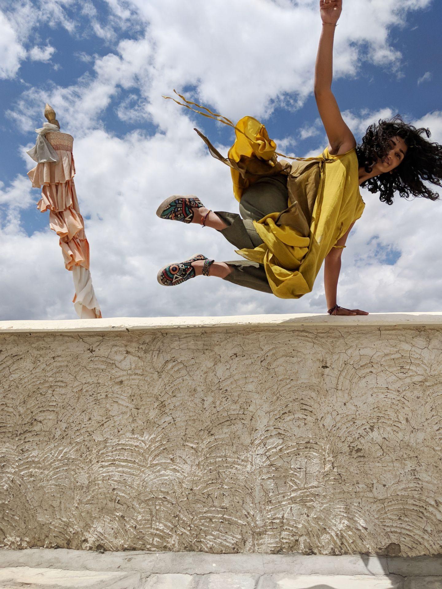 Jumping wearing yellow ladkah shot by google pixel stunt acrobatics