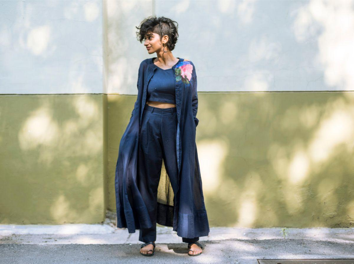 Posing blue attire diwali special brand side profile green wall
