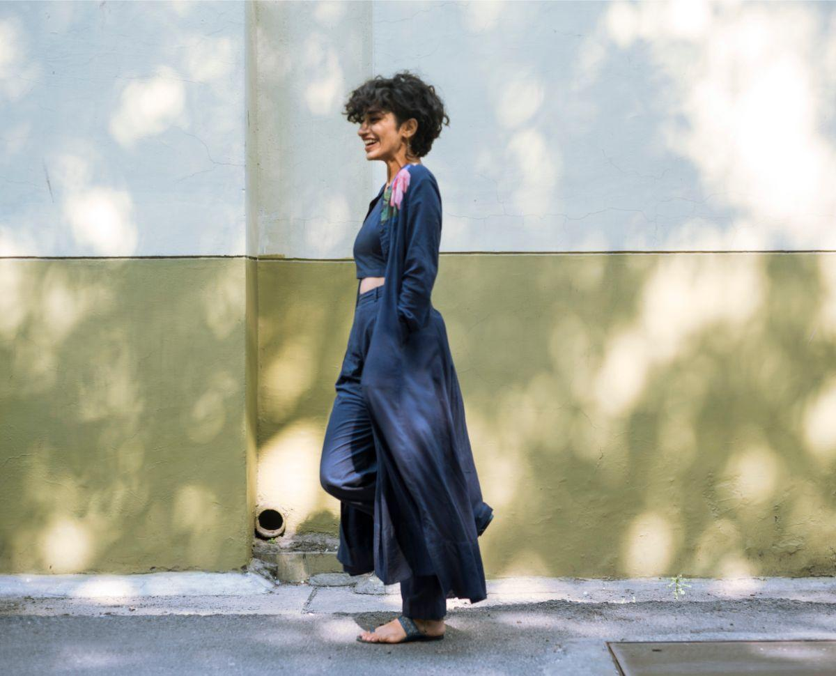 Posing side profile wearing flowy blue attire diwali modelling