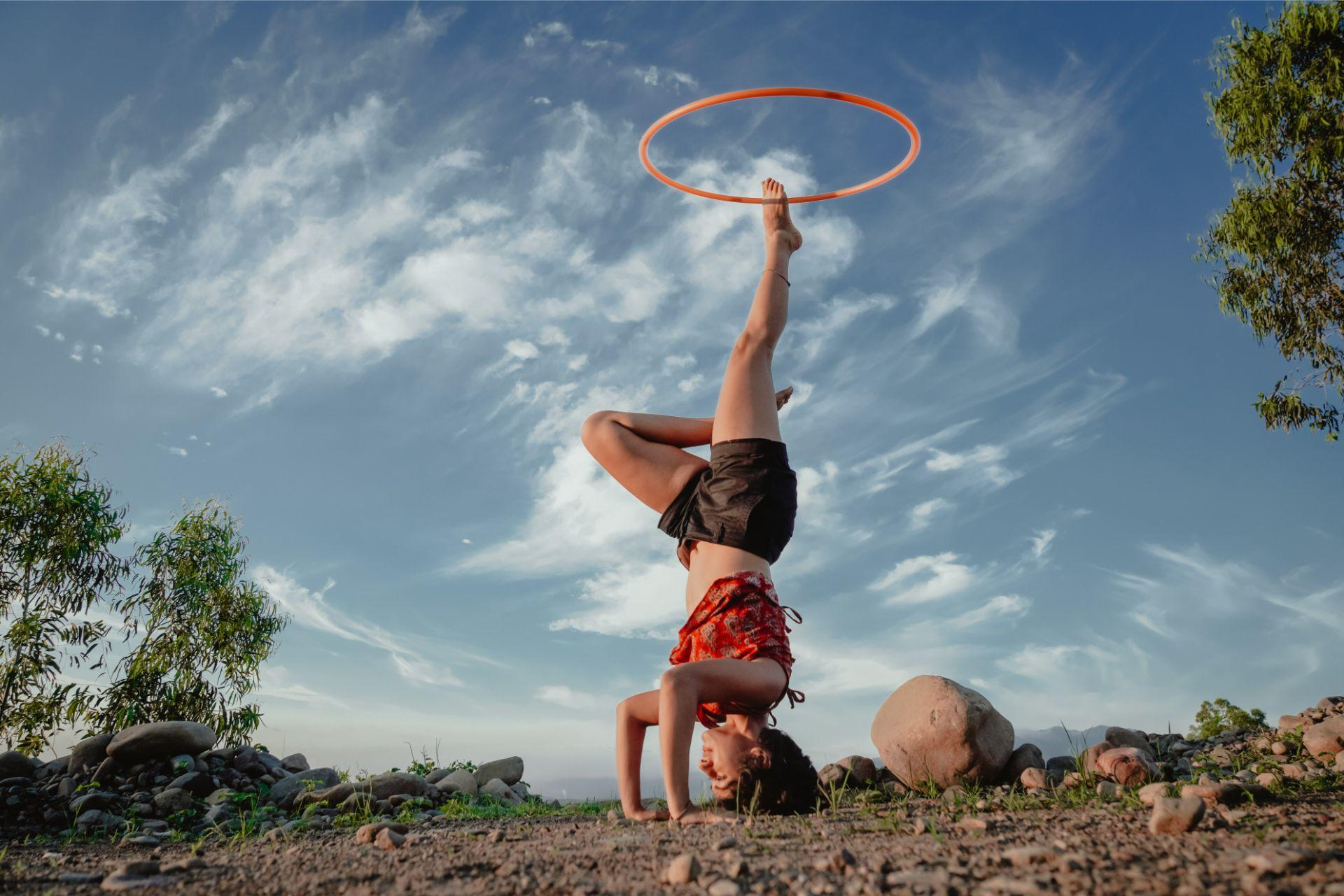 backbend yellow hoop blue sky hula