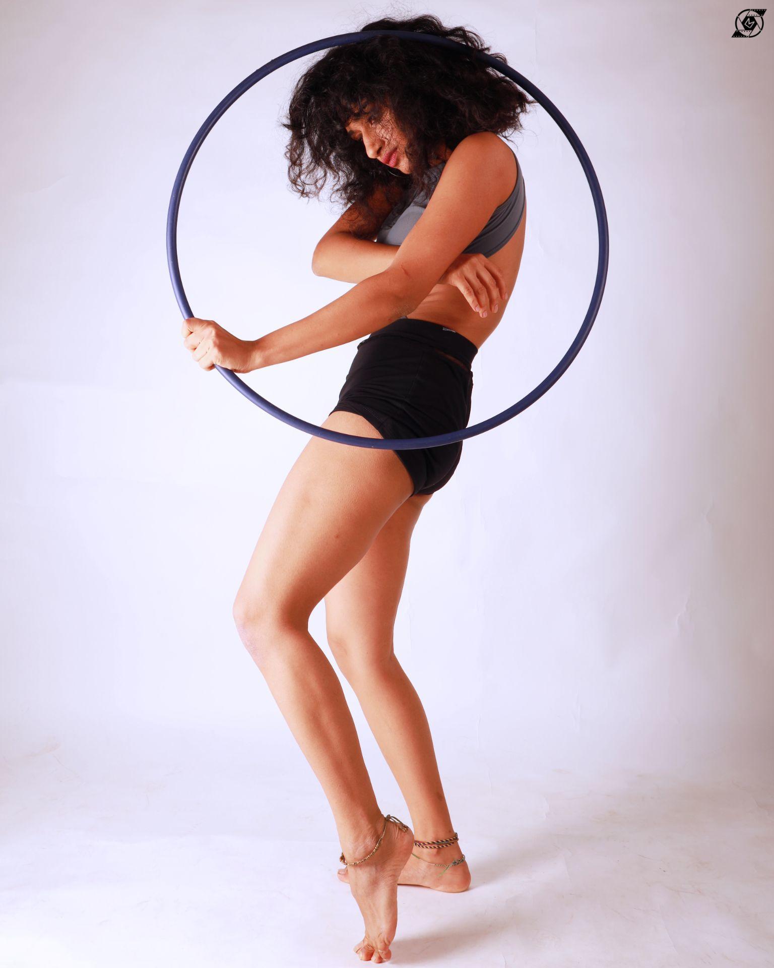 hoop leotard white background posing model shorts flexibility