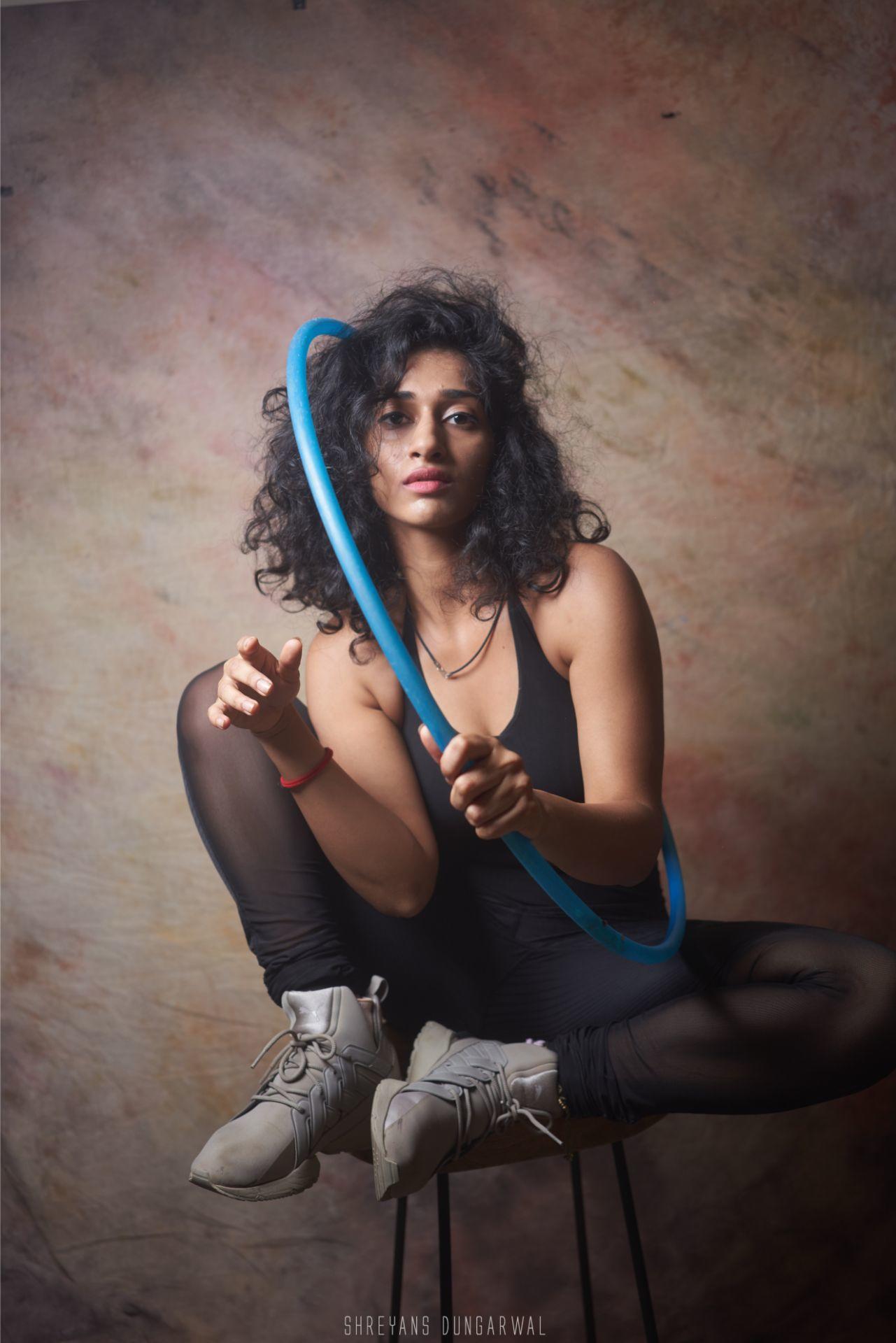 Posing with hula hoop attitude wearing black model