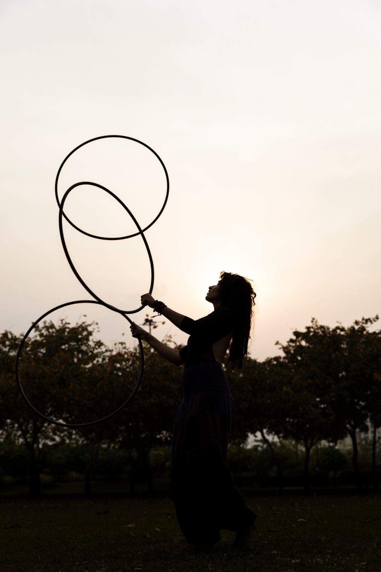 Juggling hoop hula sunset pose